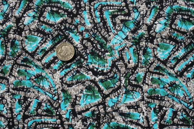 Turquoise black and grey cotton print.