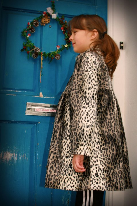 snow leopard coat, side view