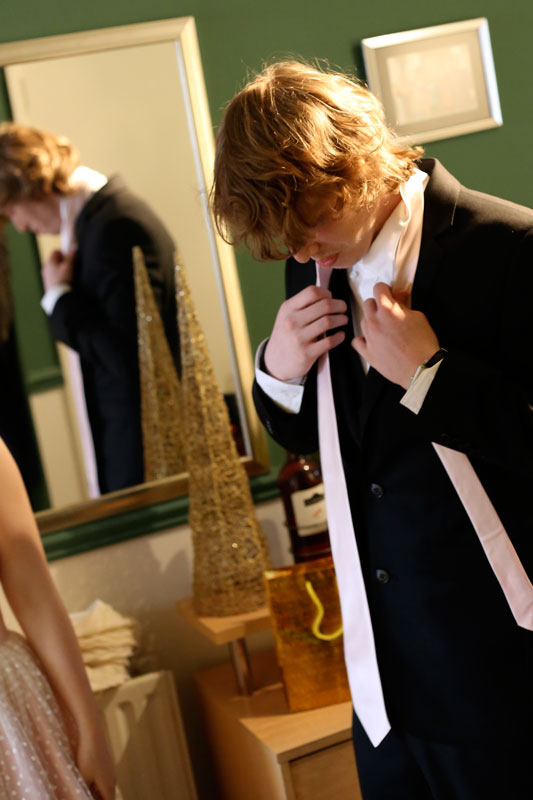 Tom putting on his tie