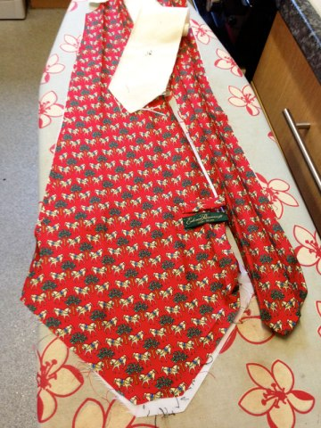 Carefully unpicked tie!