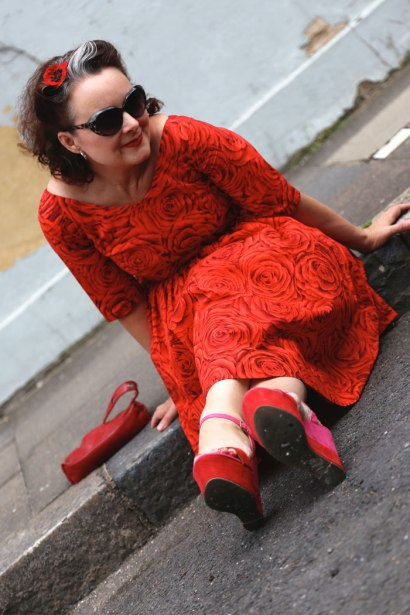 red rose lawn dress on the kerb
