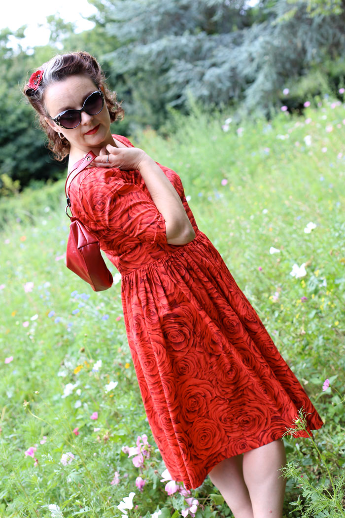 red rose lawn dress in the park