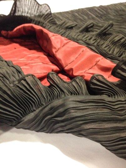 detail of pleat dress