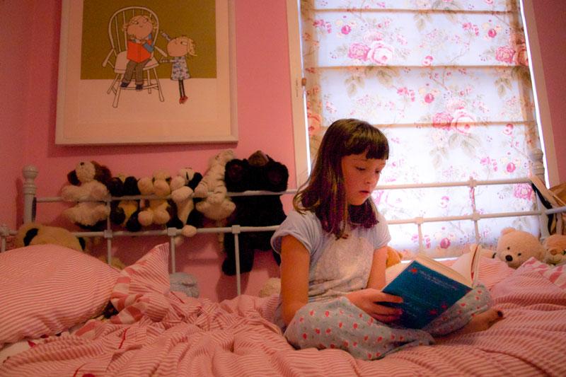 reading a book in mini stanley pjs